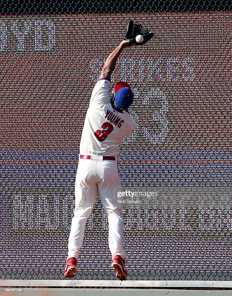Right fielder <a gi-track='captionPersonalityLinkClicked' href=/galleries/search?phrase=Delmon+Young&family=editorial&specificpeople=700362 ng-click='$event.stopPropagation()'>Delmon Young</a> #3 of the Philadelphia Phillies can't make a catch on a ball that was a triple hit by Jean Segura #9 of the Milwaukee Brewers, scoring Norichika Aoki #7 in the fifth inning against the Philadelphia Phillies in a MLB baseball game on June 1, 2013 at Citizens Bank Park in Philadelphia, Pennsylvania. The Brewers defeated the Phillies 4-3.