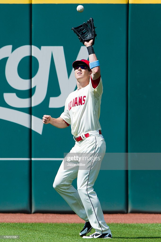 Right fielder Drew Stubbs #11 of the Cleveland Indians catches a fly ball hit by Ian Desmond #20 of the Washington Nationals during the ninth inning at Progressive Field on June 16, 2013 in Cleveland, Ohio. The Indians defeated the Nationals 2-0.