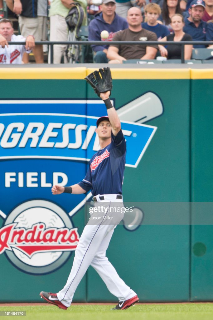 Right fielder Drew Stubbs #11 of the Cleveland Indians catches a flyball hit by Daniel Murphy #28 of the New York Mets during the first inning at Progressive Field on September 7, 2013 in Cleveland, Ohio.