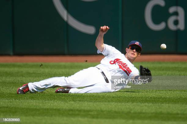 Right fielder Drew Stubbs of the Cleveland Indians drops a fly ball hit by Emilio Bonifacio of the Kansas City Royals during the first inning at...