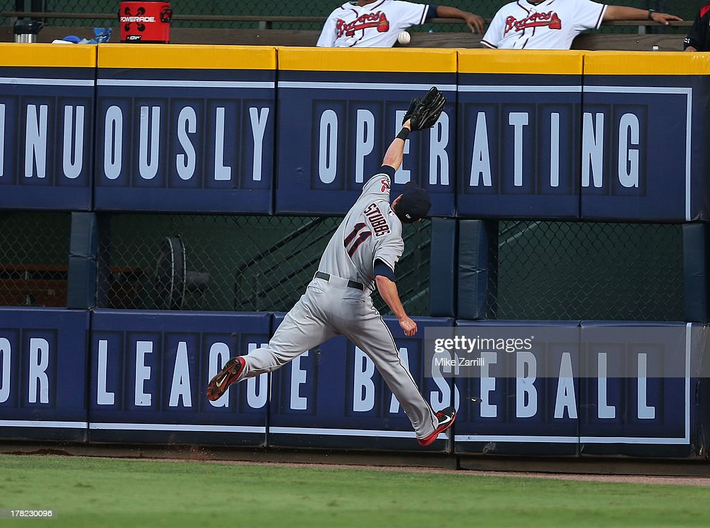Right fielder Drew Stubbs #11 of the Cleveland Indians jumps and just misses a fly ball hit by Elliot Johnson #30 of the Atlanta Braves (not pictured) during the game at Turner Field on August 27, 2013 in Atlanta, Georgia.
