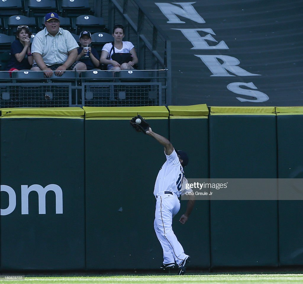 Right fielder Eric Thames #10 of the Seattle Mariners makes a catch at the warning track on a ball hit by Sam Fuld of the Tampa Bay Rays at Safeco Field on August 15, 2012 in Seattle, Washington. Starting pitcher Felix Hernandez threw a perfect game to defeat the Rays 1-0.