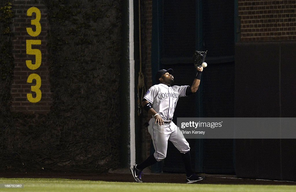 Right fielder Eric Young Jr. #1 of the Colorado Rockies drops a fly ball hit by Starlin Castro (not pictured) of the Chicago Cubs during the eighth inning on May 14, 2013 at Wrigley Field in Chicago, Illinois.