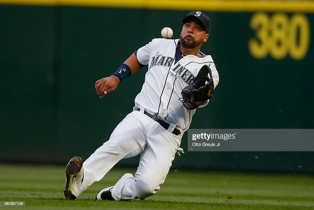 Right fielder Franklin Gutierrez of the Seattle Mariners catches a fly ball off the bat of Justin Upton of the Detroit Tigers in the third inning at...
