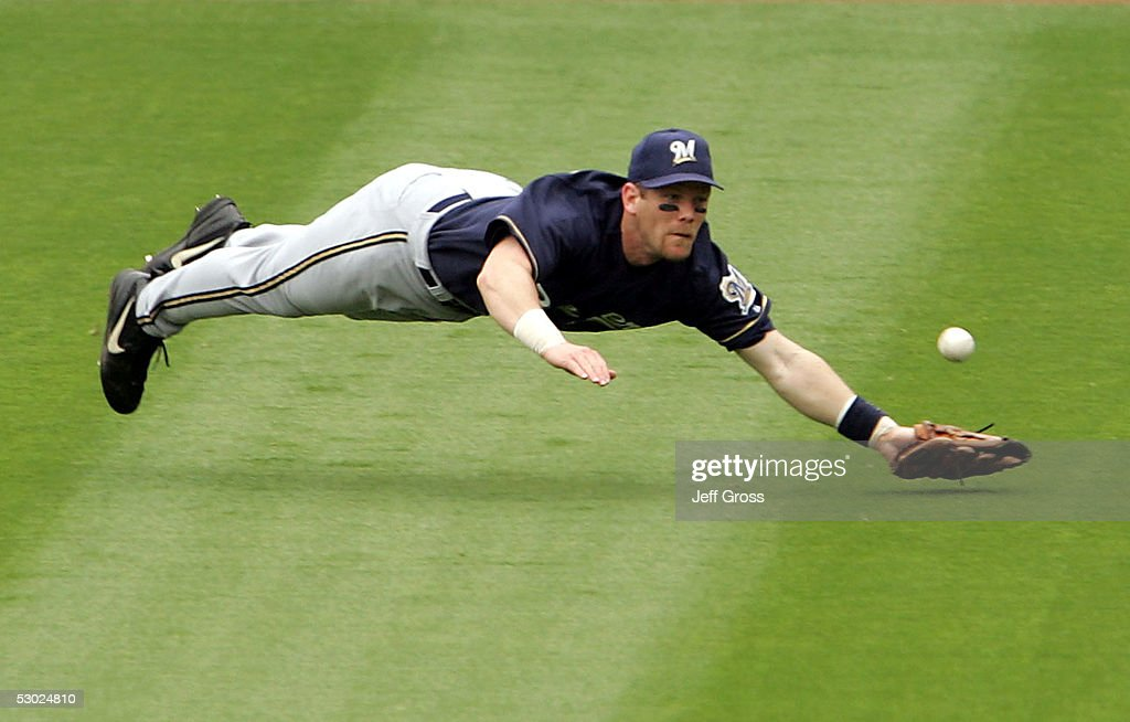 Right fielder Geoff Jenkins #5 of the Milwaukee Brewers dives for a ball but can't make the catch allowing two runs to score on a triple by Jayson Werth #28 of the Los Angeles Dodgers in the third inning at Dodger Stadium on June 5, 2005 in Los Angeles, California.