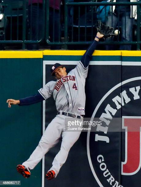 Right fielder George Springer of the Houston Astros gets his glove on the home run hit by Miguel Cabrera of the Detroit Tigers but can't haul it in...