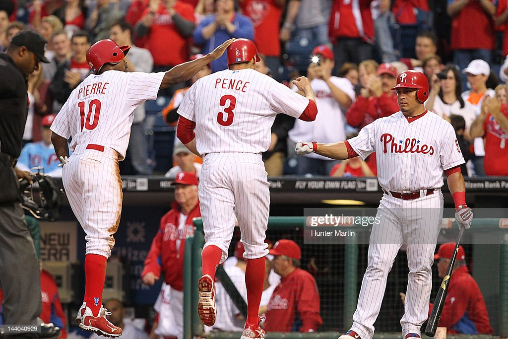 Right fielder Hunter Pence #3 of the Philadelphia Phillies is congratulated by left fielder Juan Pierre #10 and catcher Carlos Ruiz #51 after hitting a two-run home run during a game against the New York Mets at Citizens Bank Park on May 8, 2012 in Philadelphia, Pennsylvania.