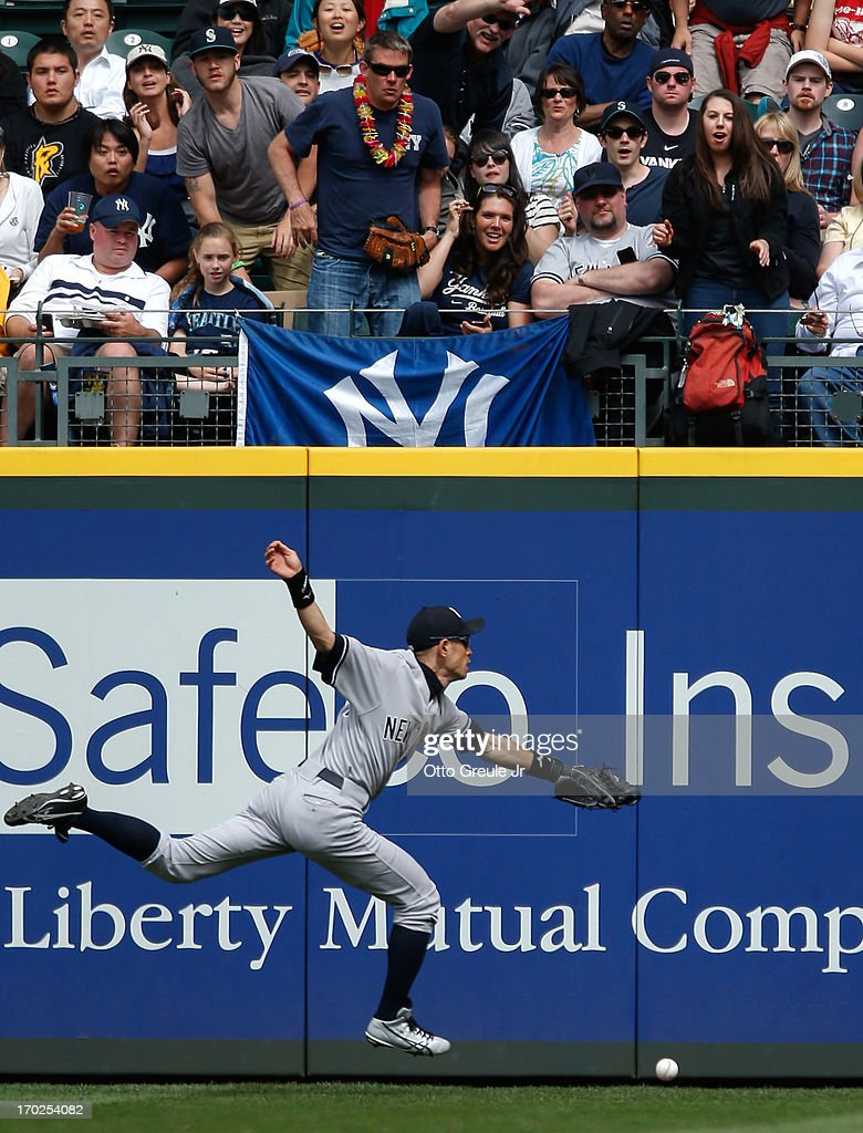 Right fielder Ichiro Suzuki #31 of the New York Yankees chases down a double by Alex Liddi of the Seattle Mariners at Safeco Field on June 9, 2013 in Seattle, Washington. The Yankees defeated the Mariners 2-1.
