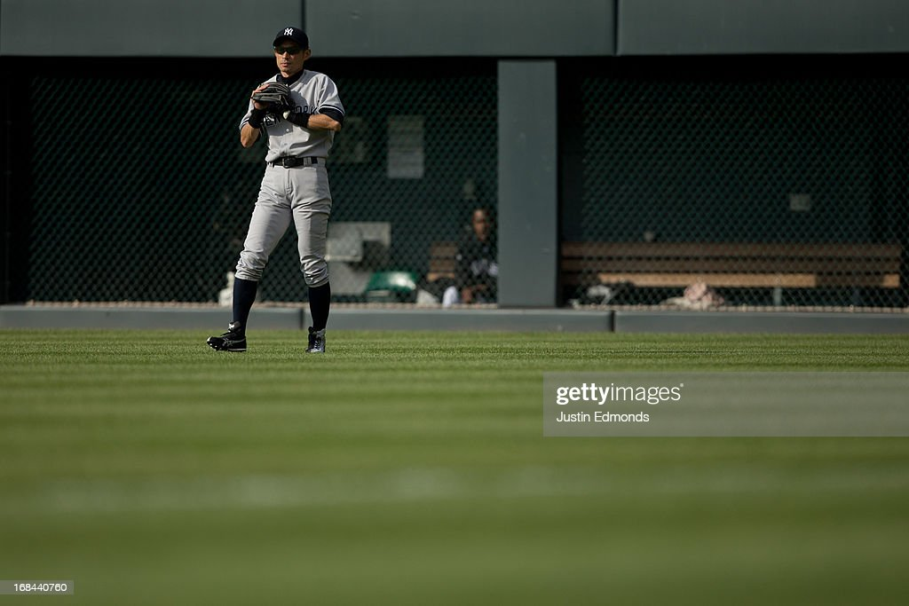 Right fielder <a gi-track='captionPersonalityLinkClicked' href=/galleries/search?phrase=Ichiro+Suzuki&family=editorial&specificpeople=201556 ng-click='$event.stopPropagation()'>Ichiro Suzuki</a> #31 of the New York Yankees prepares for the pitch against the Colorado Rockies at Coors Field on May 9, 2013 in Denver, Colorado. The Yankees defeated the Rockies 3-1 to win the series.
