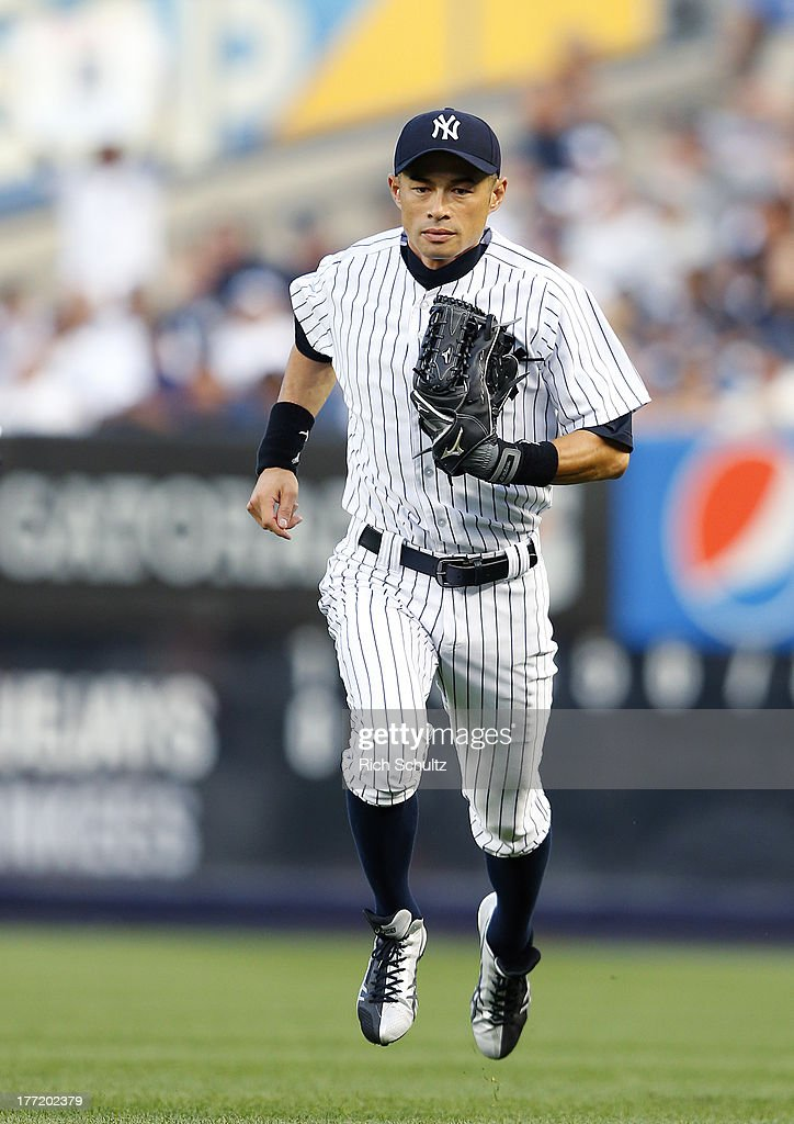 Right fielder Ichiro Suzuki #31 of the New York Yankees runs back to the dugout during a game against the Toronto Blue Jays. Ichiro singled in the first inning for his 4,000 career hit at Yankee Stadium on August 121, 2013 in the Bronx borough of New York City.