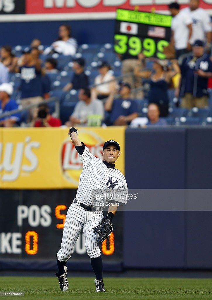 Right fielder Ichiro Suzuki #31 of the New York Yankees warms up in the outfield before the start of a game against the Toronto Blue Jays. Ichiro singled in the first inning for his 4,000th career hit at Yankee Stadium on August 21, 2013 in the Bronx borough of New York City.