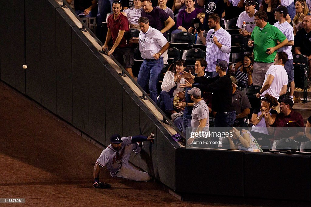 Right fielder Jason Heyward #22 of the Atlanta Braves goes crashing into the wall on an attempt to catch a foul ball against the Colorado Rockies at Coors Field on May 4, 2012 in Denver, Colorado.