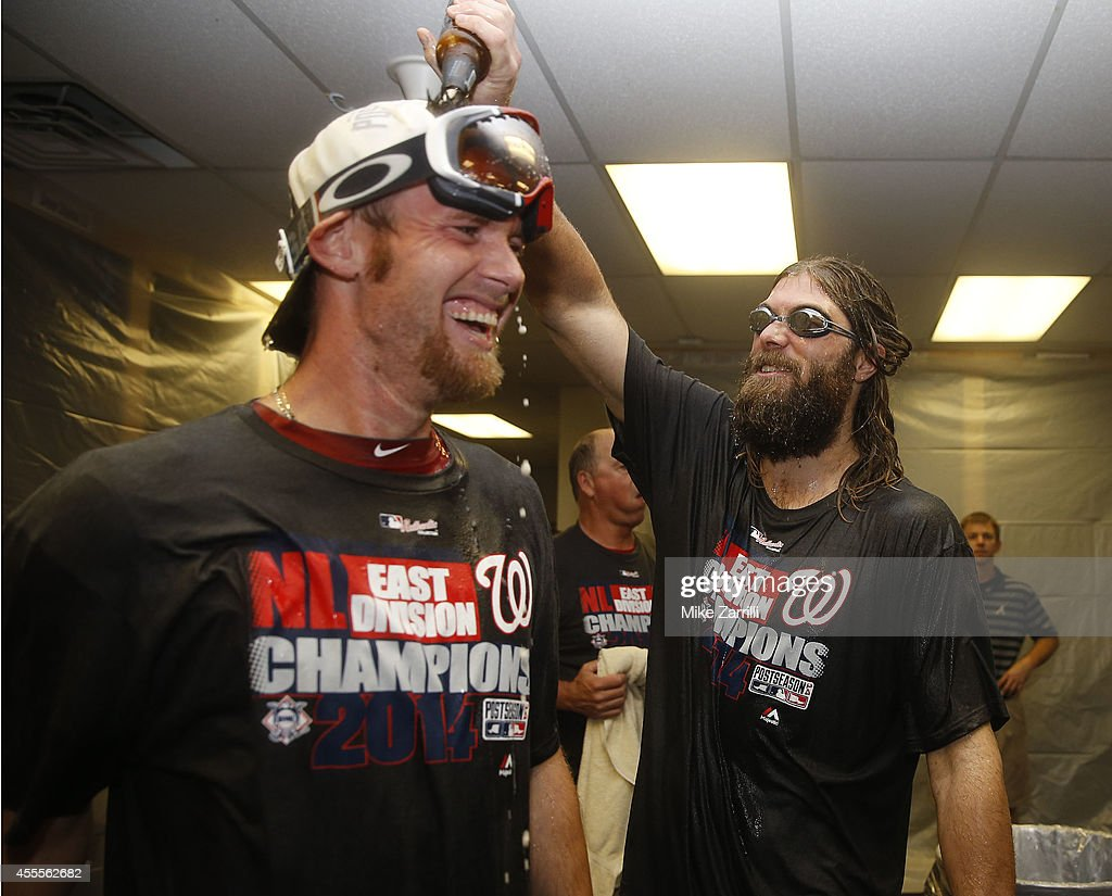 Right fielder <a gi-track='captionPersonalityLinkClicked' href=/galleries/search?phrase=Jayson+Werth&family=editorial&specificpeople=206490 ng-click='$event.stopPropagation()'>Jayson Werth</a> #28 of the Washington Nationals douses pitcher <a gi-track='captionPersonalityLinkClicked' href=/galleries/search?phrase=Stephen+Strasburg&family=editorial&specificpeople=6164496 ng-click='$event.stopPropagation()'>Stephen Strasburg</a> #38 after the division clinching game against the Atlanta Braves at Turner Field on September 16, 2014 in Atlanta, Georgia.