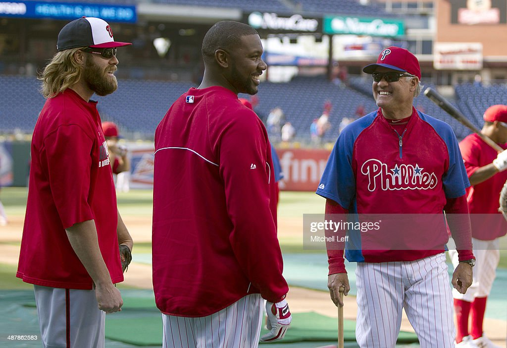 Right fielder Jayson Werth #28 of the Washington Nationals, first baseman Ryan Howard #6 and manager Ryne Sandberg #23 of the Philadelphia Phillies share a laugh prior to their game on May 2, 2014 at Citizens Bank Park in Philadelphia, Pennsylvania.