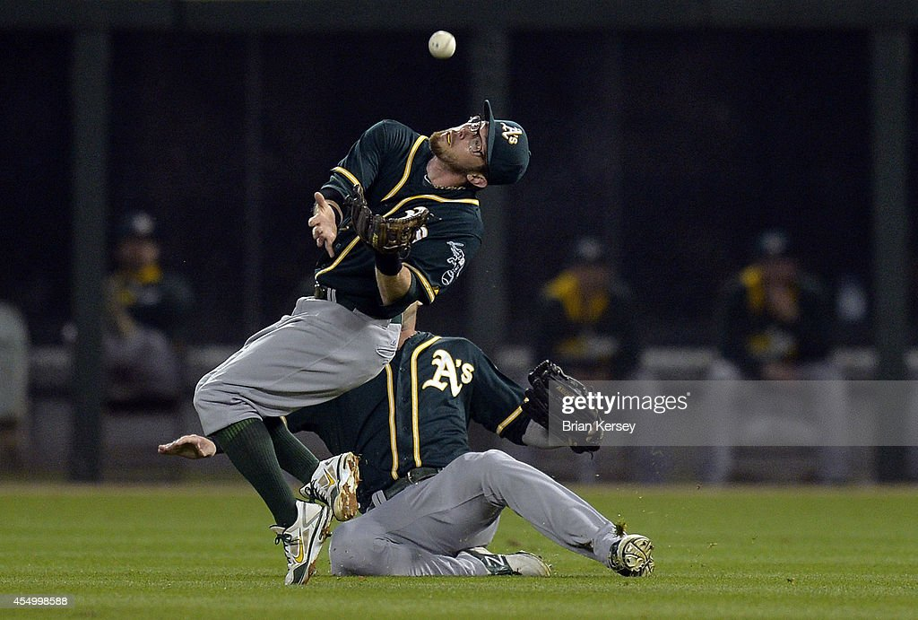 Right fielder <a gi-track='captionPersonalityLinkClicked' href=/galleries/search?phrase=Josh+Reddick&family=editorial&specificpeople=5746348 ng-click='$event.stopPropagation()'>Josh Reddick</a> #16 of the Oakland Athletics (R) avoids second baseman <a gi-track='captionPersonalityLinkClicked' href=/galleries/search?phrase=Eric+Sogard&family=editorial&specificpeople=6796459 ng-click='$event.stopPropagation()'>Eric Sogard</a> #28 as he catches a pop-up hit by Andy Wilkins #38 of the Chicago White Sox during the first inning at U.S. Cellular Field on September 8, 2014 in Chicago, Illinois.