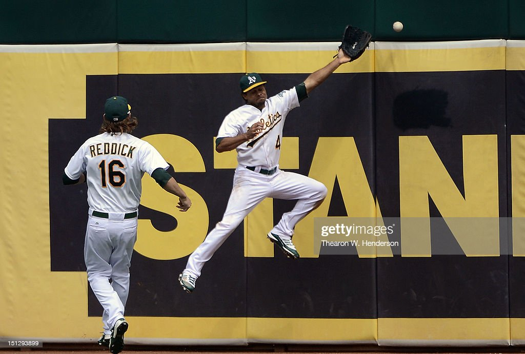 Right fielder <a gi-track='captionPersonalityLinkClicked' href=/galleries/search?phrase=Josh+Reddick&family=editorial&specificpeople=5746348 ng-click='$event.stopPropagation()'>Josh Reddick</a> #16 of the Oakland Athletics looks on as <a gi-track='captionPersonalityLinkClicked' href=/galleries/search?phrase=Coco+Crisp&family=editorial&specificpeople=206376 ng-click='$event.stopPropagation()'>Coco Crisp</a> #4 leaps but can't make the catch as the ball hits the right centerfield off the bat of Howie Kendrick #47 of the Los Angeles Angels of Anaheim (not pictured) in the six inning at O.co Coliseum on September 5, 2012 in Oakland, California.