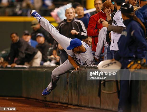 Right fielder Justin Maxwell of the Kansas City Royals goes into the stands in pursuit of a foul ball off the bat of Nick Franklin of the Seattle...