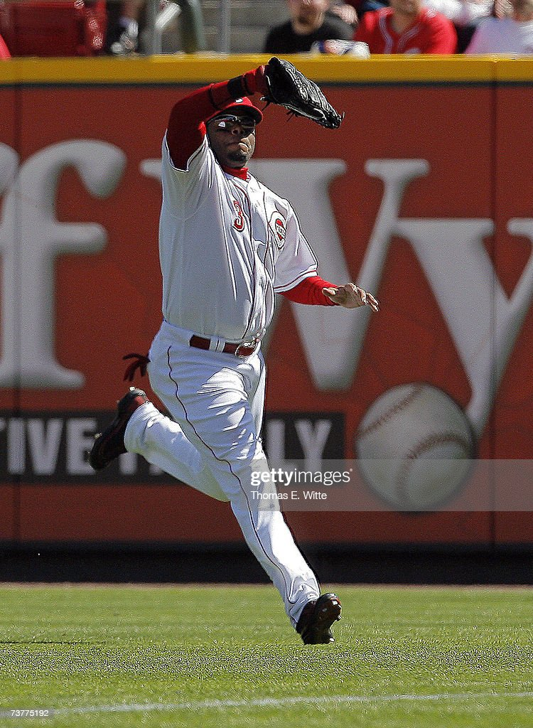Right fielder Ken Griffey Jr #3 of the Cincinnati Reds makes a running catch on a fly ball against the Chicago Cubs on Opening Day April 2 2007 at...