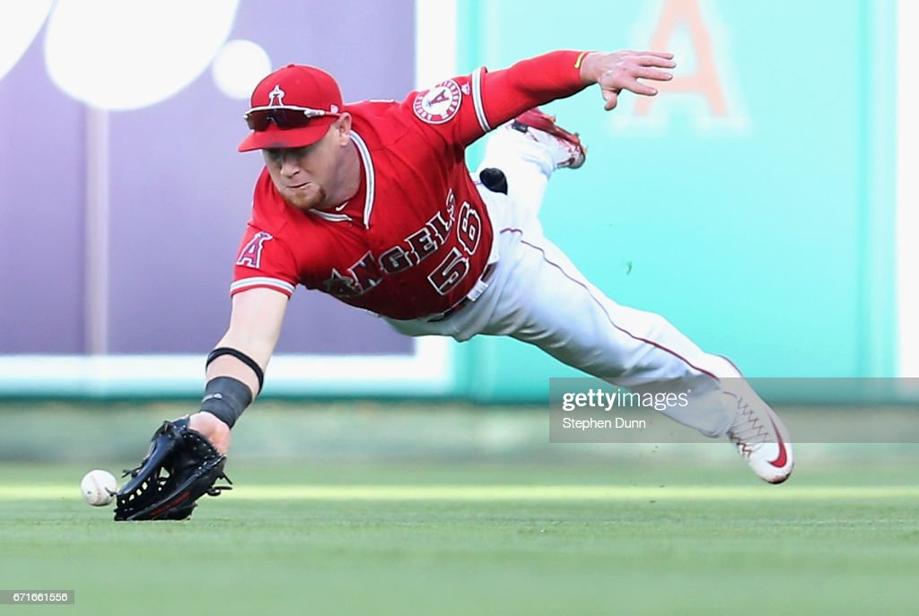 Right fielder Kole Calhoun #56 of the Los Angeles Angels of Anaheim dives but can't reach a single hit by Kendrys Morales #8 of the Toronto Blue Jays in the first inning at Angel Stadium of Anaheim on April 22, 2017 in Anaheim, California.