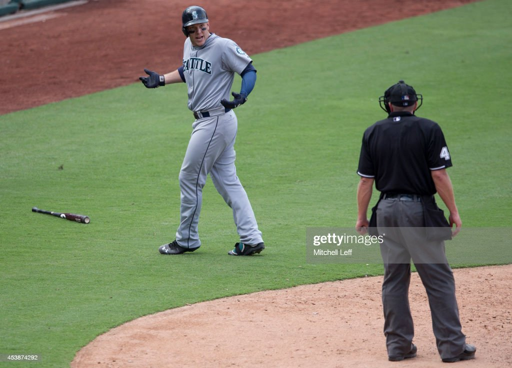 Right fielder <a gi-track='captionPersonalityLinkClicked' href=/galleries/search?phrase=Logan+Morrison&family=editorial&specificpeople=5690834 ng-click='$event.stopPropagation()'>Logan Morrison</a> #20 of the Seattle Mariners argues with home plate umpire <a gi-track='captionPersonalityLinkClicked' href=/galleries/search?phrase=Ron+Kulpa&family=editorial&specificpeople=2141033 ng-click='$event.stopPropagation()'>Ron Kulpa</a> #46 in the top of the eighth inning against the Philadelphia Phillies on August 20, 2014 at Citizens Bank Park in Philadelphia, Pennsylvania.