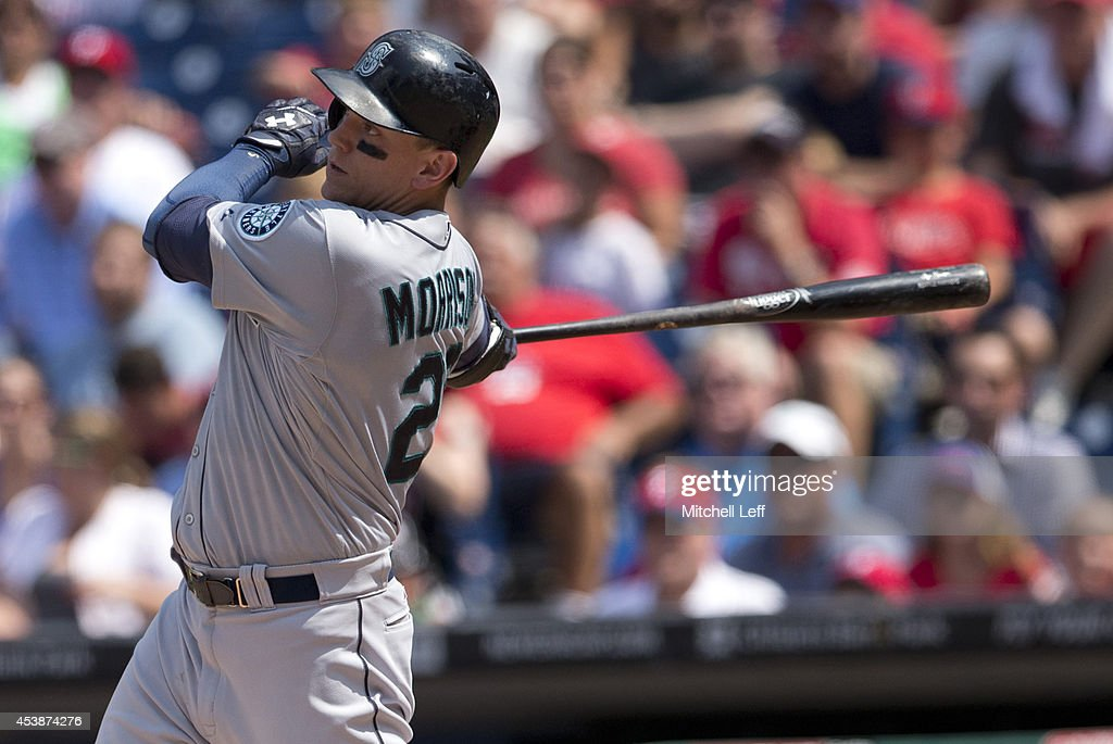 Right fielder <a gi-track='captionPersonalityLinkClicked' href=/galleries/search?phrase=Logan+Morrison&family=editorial&specificpeople=5690834 ng-click='$event.stopPropagation()'>Logan Morrison</a> #20 of the Seattle Mariners hits an RBI double in the top of the fourth inning against the Philadelphia Phillies on August 20, 2014 at Citizens Bank Park in Philadelphia, Pennsylvania.