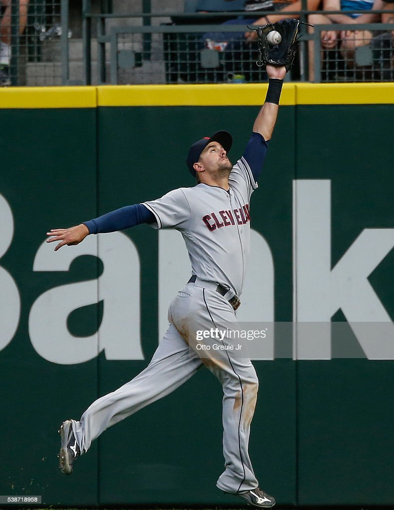 Right fielder <a gi-track='captionPersonalityLinkClicked' href=/galleries/search?phrase=Lonnie+Chisenhall&family=editorial&specificpeople=6796448 ng-click='$event.stopPropagation()'>Lonnie Chisenhall</a> #8 of the Cleveland Indians catches a fly ball off the bat of Kyle Seager of the Seattle Mariners in the fourth inning at Safeco Field on June 7, 2016 in Seattle, Washington.
