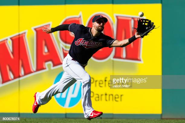 Right fielder Lonnie Chisenhall of the Cleveland Indians catches a fly ball hit by Robbie Grossman of the Minnesota Twins to end the top of the fifth...