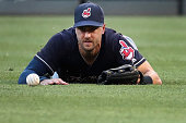 Right fielder Lonnie Chisenhall of the Cleveland Indians misses a ball hit by Manny Machado of the Baltimore Orioles for a first inning single at...