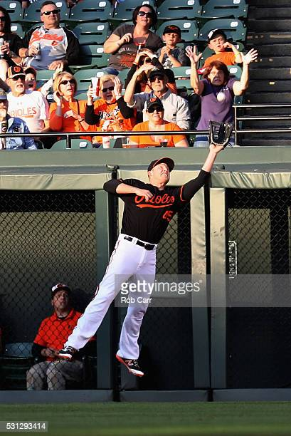 Right fielder Mark Trumbo of the Baltimore Orioles catches a ball hit by Miguel Cabrera of the Detroit Tigers for the second out of the first inning...