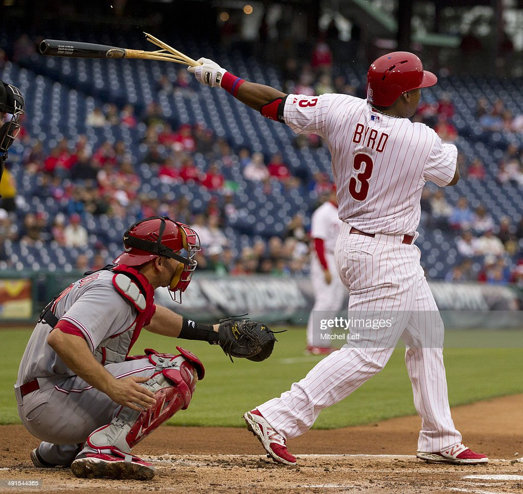 Right fielder <a gi-track='captionPersonalityLinkClicked' href=/galleries/search?phrase=Marlon+Byrd&family=editorial&specificpeople=217377 ng-click='$event.stopPropagation()'>Marlon Byrd</a> #3 of the Philadelphia Phillies breaks his bat in the bottom of the first inning against the Cincinnati Reds on May 16, 2014 at Citizens Bank Park in Philadelphia, Pennsylvania.