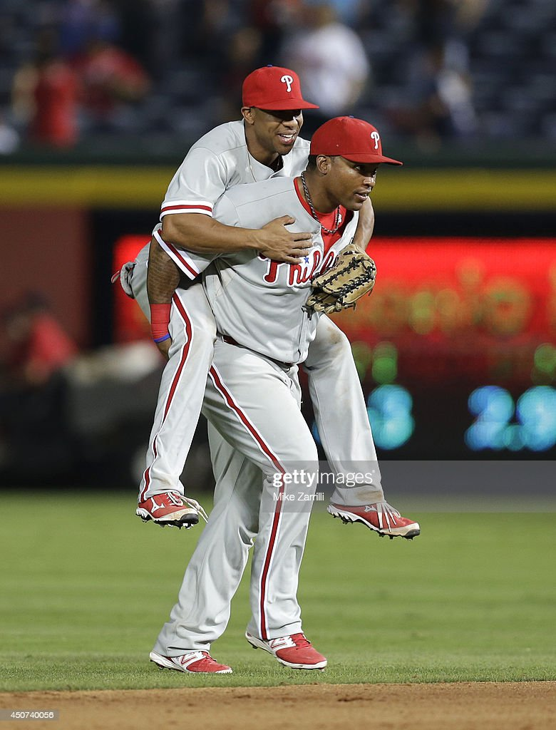 Right fielder Marlon Byrd #3 of the Philadelphia Phillies carries centerfielder Ben Revere #2 off the field after the game against the Atlanta Braves at Turner Field on June 16, 2014 in Atlanta, Georgia.