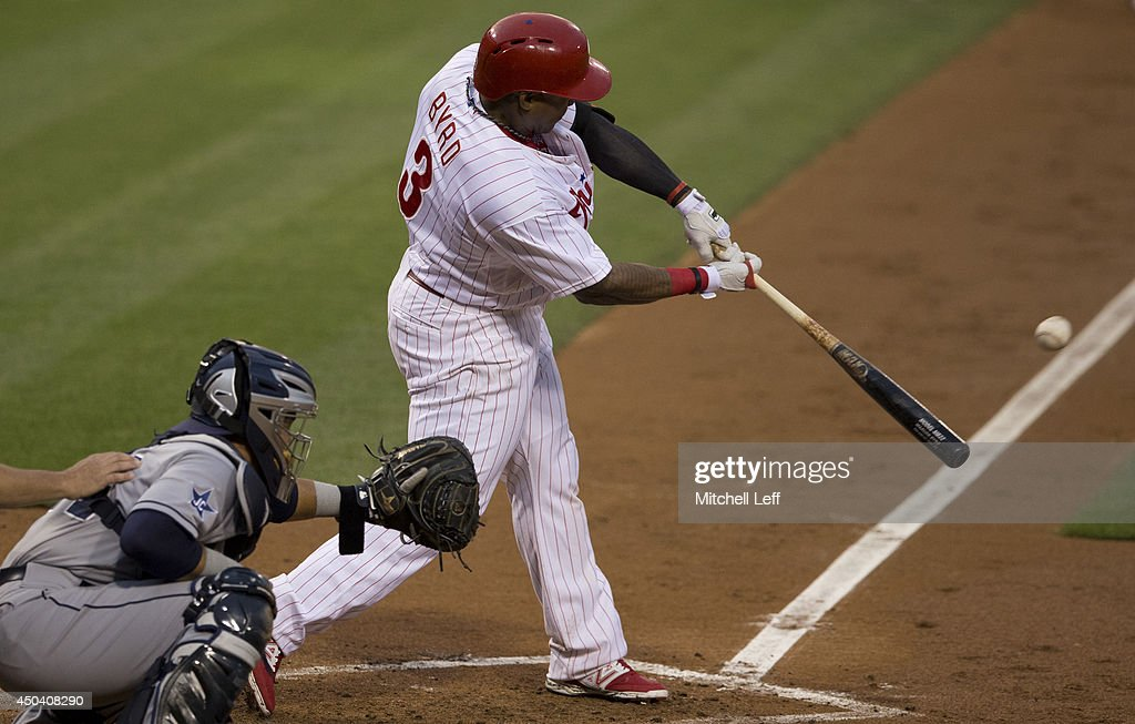 Right fielder <a gi-track='captionPersonalityLinkClicked' href=/galleries/search?phrase=Marlon+Byrd&family=editorial&specificpeople=217377 ng-click='$event.stopPropagation()'>Marlon Byrd</a> #3 of the Philadelphia Phillies hits a three run home run in the bottom of the fourth inning against the San Diego Padres on June 10, 2014 at Citizens Bank Park in Philadelphia, Pennsylvania.