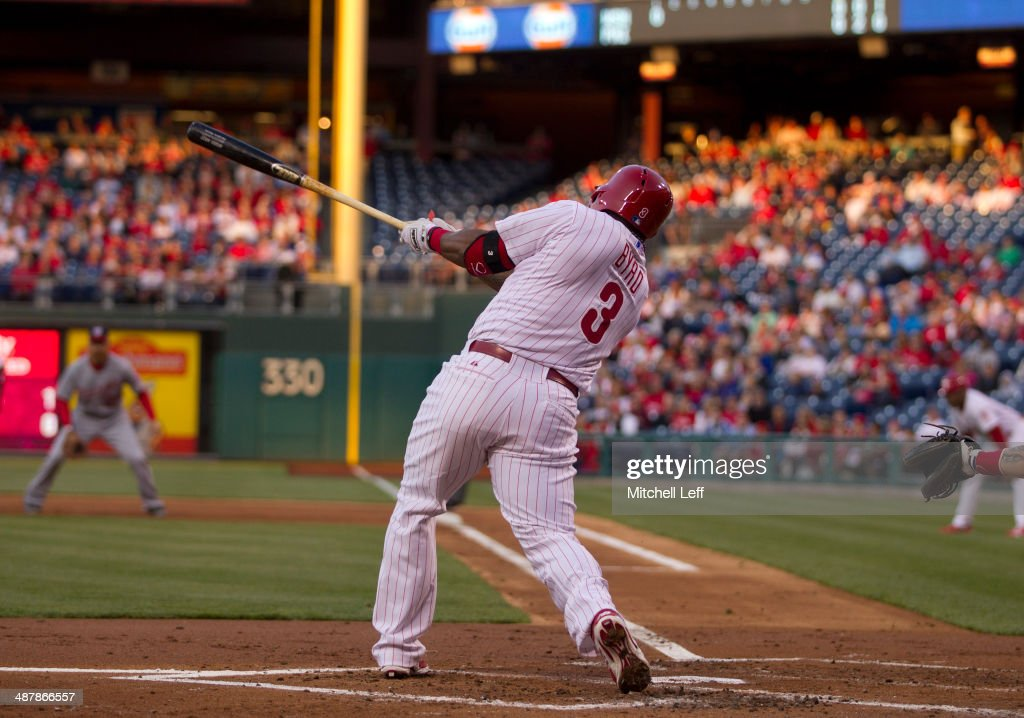 Right fielder Marlon Byrd #3 of the Philadelphia Phillies hits a three run home run in the first inning against the Washington Nationals on May 2, 2014 at Citizens Bank Park in Philadelphia, Pennsylvania.