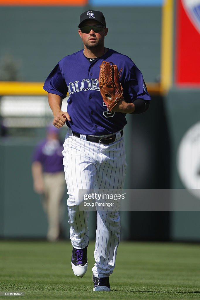 Right fielder <a gi-track='captionPersonalityLinkClicked' href=/galleries/search?phrase=Michael+Cuddyer&family=editorial&specificpeople=208127 ng-click='$event.stopPropagation()'>Michael Cuddyer</a> #3 of the Colorado Rockies jogs toward the dugout between innings against the San Francisco Giants on Opening Day at Coors Field on April 9, 2012 in Denver, Colorado. The Giants defeated the Rockies 7-0.