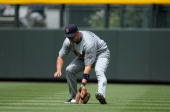 Right fielder Michael Cuddyer of the Minnesota Twins plays defense against the Colorado Rockies during Interleague MLB action at Coors Field on May...