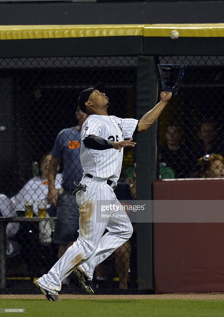 Right fielder <a gi-track='captionPersonalityLinkClicked' href=/galleries/search?phrase=Moises+Sierra&family=editorial&specificpeople=7509137 ng-click='$event.stopPropagation()'>Moises Sierra</a> #25 of the Chicago White Sox catches a fly ball hit by Danny Santana #39 of the Minnesota Twins during the sixth inning at U.S. Cellular Field on August 1, 2014 in Chicago, Illinois.