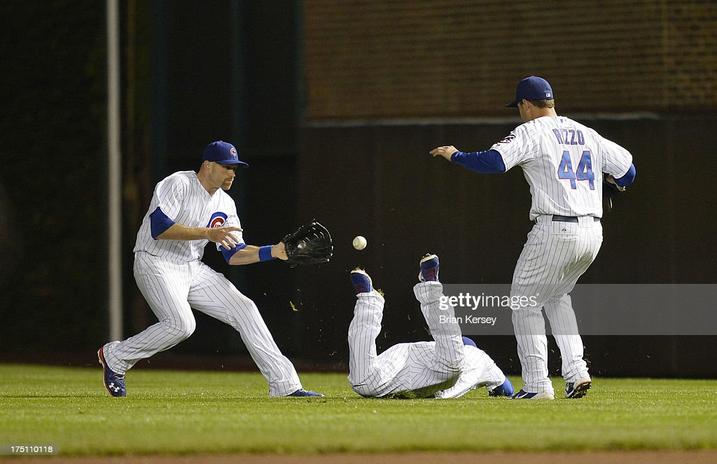 Right fielder <a gi-track='captionPersonalityLinkClicked' href=/galleries/search?phrase=Nate+Schierholtz&family=editorial&specificpeople=803208 ng-click='$event.stopPropagation()'>Nate Schierholtz</a> #19, second baseman <a gi-track='captionPersonalityLinkClicked' href=/galleries/search?phrase=Luis+Valbuena&family=editorial&specificpeople=5537111 ng-click='$event.stopPropagation()'>Luis Valbuena</a> #24 and first baseman <a gi-track='captionPersonalityLinkClicked' href=/galleries/search?phrase=Anthony+Rizzo&family=editorial&specificpeople=7551494 ng-click='$event.stopPropagation()'>Anthony Rizzo</a> #44 of the Chicago Cubs cannot get to a fly ball hit by Jeff Bianchi #14 of the Milwaukee Brewers during the ninth inning at Wrigley Field on July 31, 2013 in Chicago, Illinois. Scooter Gennett #2 of the Milwaukee Brewers was forced out at second base on the play. The Cubs defeated the Brewers 6-1.