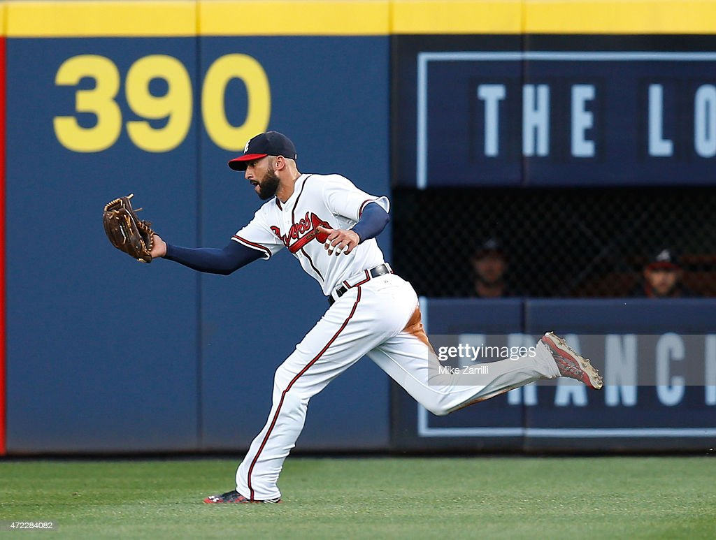 Right fielder Nick Markakis of the Atlanta Braves makes a catch in the third inning during the game against the Philadelphia Phillies at Turner Field...