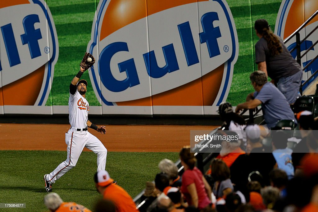 Right fielder <a gi-track='captionPersonalityLinkClicked' href=/galleries/search?phrase=Nick+Markakis&family=editorial&specificpeople=614708 ng-click='$event.stopPropagation()'>Nick Markakis</a> #21 of the Baltimore Orioles makes a catch on Jose Altuve #27 of the Houston Astros (not pictured) in the fifth inning at Oriole Park at Camden Yards on July 30, 2013 in Baltimore, Maryland. The Baltimore Orioles won, 4-3.