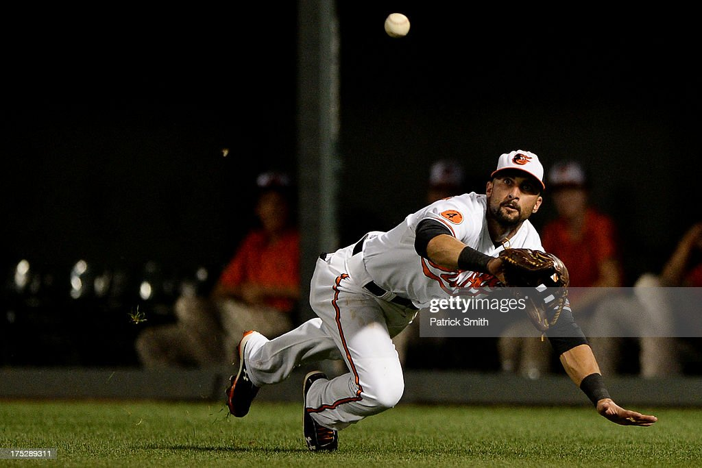 Right fielder <a gi-track='captionPersonalityLinkClicked' href=/galleries/search?phrase=Nick+Markakis&family=editorial&specificpeople=614708 ng-click='$event.stopPropagation()'>Nick Markakis</a> #21 of the Baltimore Orioles makes a catch on a hit by Jason Castro #15 of the Houston Astros (not pictured) in the eighth inning at Oriole Park at Camden Yards on August 1, 2013 in Baltimore, Maryland. The Baltimore Orioles won, 6-3.