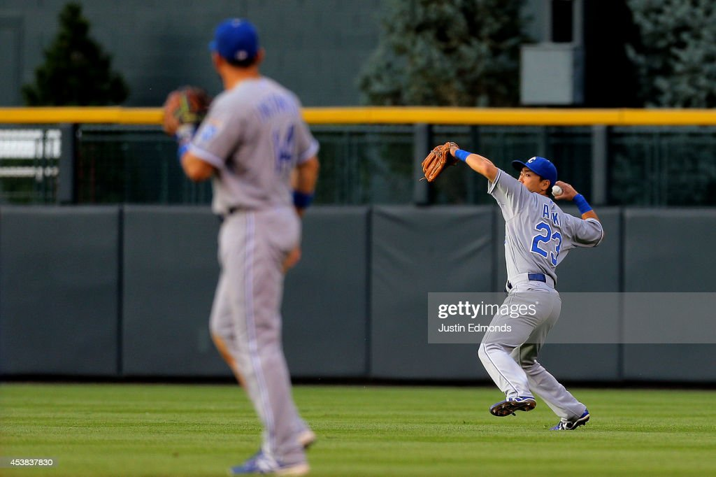 Right fielder <a gi-track='captionPersonalityLinkClicked' href=/galleries/search?phrase=Norichika+Aoki&family=editorial&specificpeople=850957 ng-click='$event.stopPropagation()'>Norichika Aoki</a> #23 of the Kansas City Royals throws to third base during the second inning as second baseman <a gi-track='captionPersonalityLinkClicked' href=/galleries/search?phrase=Omar+Infante&family=editorial&specificpeople=203255 ng-click='$event.stopPropagation()'>Omar Infante</a> #14 looks on against the Colorado Rockies at Coors Field on August 19, 2014 in Denver, Colorado.