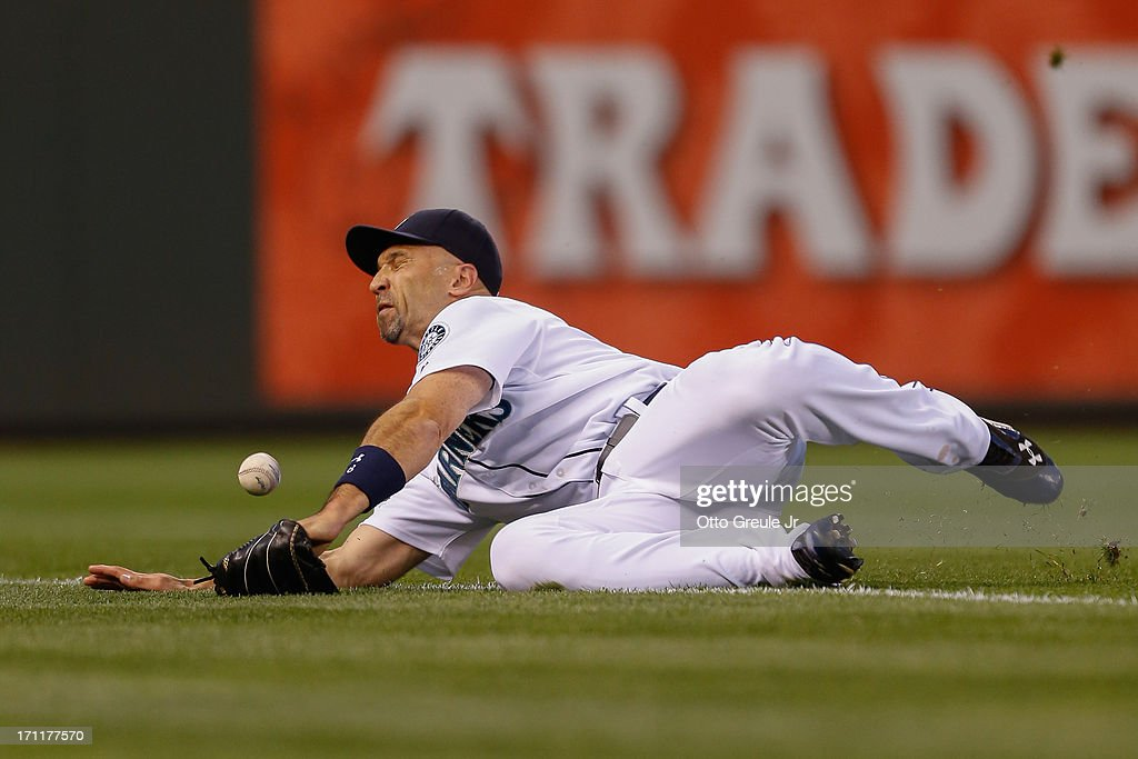 Right fielder Raul Ibanez #28 of the Seattle Mariners just misses a foul ball by Josh Reddick of the Oakland Athletics in the sixth inning at Safeco Field on June 22, 2013 in Seattle, Washington.