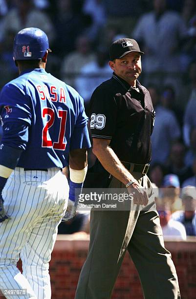 Right fielder Sammy Sosa of the Chicago Cubs has words with home plate umpire Bill Hohn after Hohn tossed Sosa from the game for arguing a called...