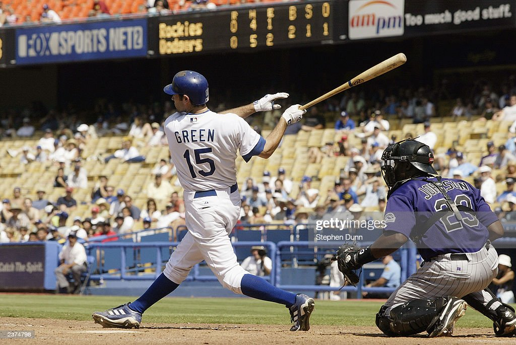 Right fielder Shawn Green of the Los Angeles Dodgers hits a single in the eleventh inning scoring second baseman Alex Cora with the games only run to...