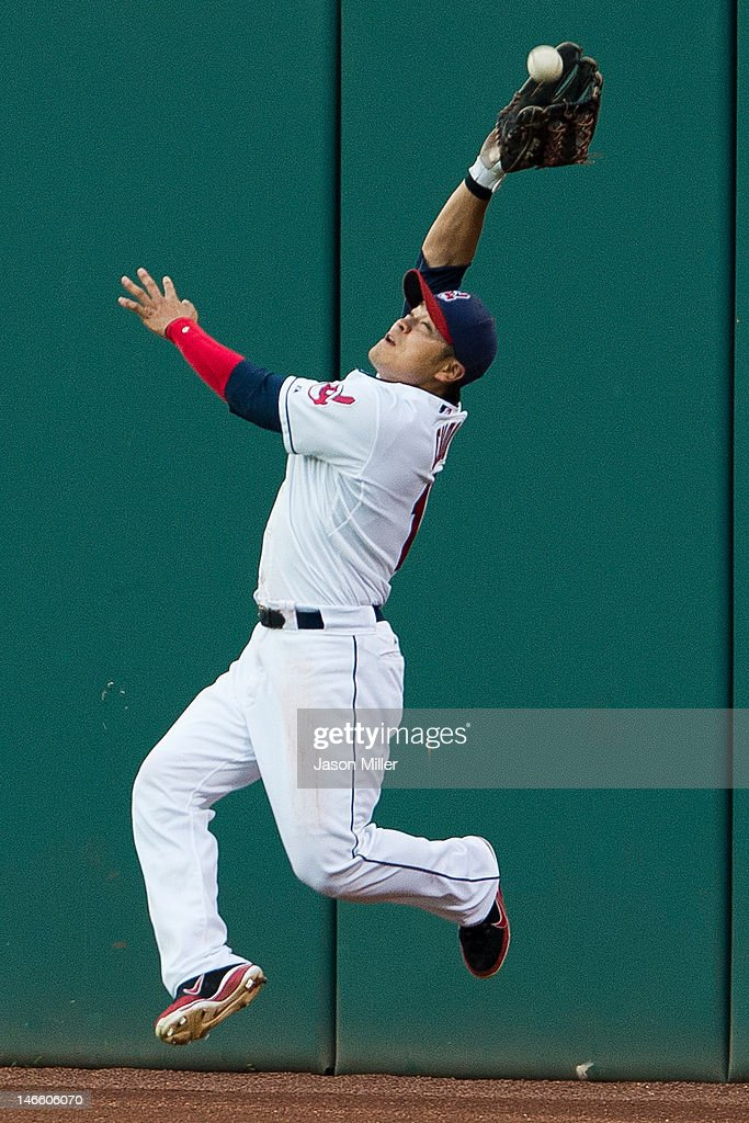 Right fielder <a gi-track='captionPersonalityLinkClicked' href=/galleries/search?phrase=Shin-Soo+Choo&family=editorial&specificpeople=196543 ng-click='$event.stopPropagation()'>Shin-Soo Choo</a> #17 of the Cleveland Indians grabs a fly ball during the fifth inning against the Cincinnati Reds during interleague play at Progressive Field on June 20, 2012 in Cleveland, Ohio.