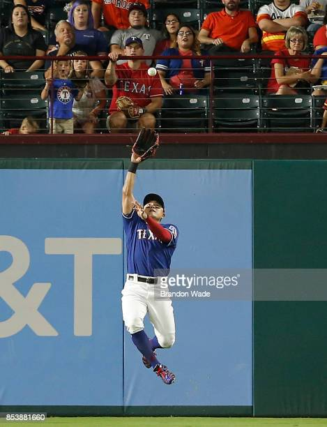 Right fielder ShinSoo Choo of the Texas Rangers catches a flyout hit by Tyler White of the Houston Astros during the fourth inning of a baseball game...