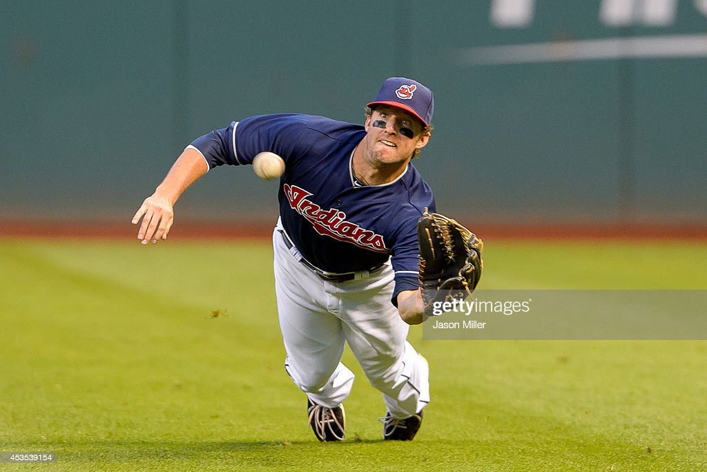 Right fielder Tyler Holt of the Cleveland Indians catches a line drive off the bat of Cliff Pennington of the Arizona Diamondbacks to end the top of...