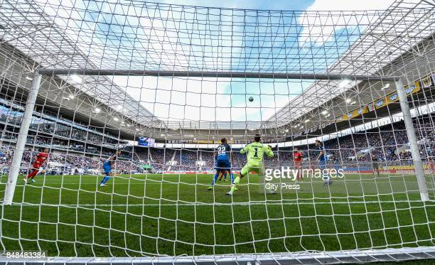 right Kevin Vogt Oliver Baumann of the TSG 1899 Hoffenheim Mathew Leckie of Hertha BSC and Havard Nordtveit of the TSG 1899 Hoffenheim during the...