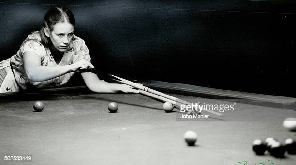 Right on cue Maryann McConnell a Canadian who is living in Saudi Arabia lines up her shot in Masters Games women's snooker competition against Sara...