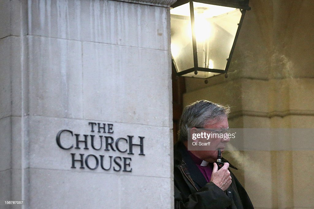 Right Reverend Martin Wharton, the Bishop of Newcastle, smokes a pipe outside Church House on November 21, 2012 in London, England. The Church of England's governing body, known as the General Synod, yesterday voted to prevent women from becoming bishops.